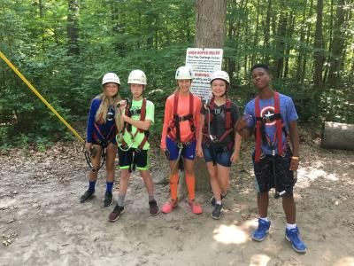 A group of campers gets ready for the zipline